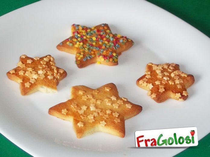 Biscotti a forma di stelle natalizie