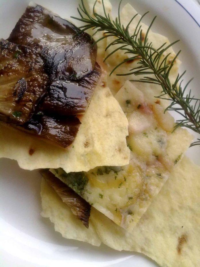 Funghi di carne e prosciutto cotto gratinati al forno con provola affumicata